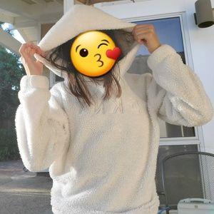 Fluffy white DKNY sweatshirt
